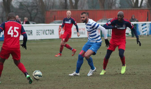Alou Diarra challenges QPR midfielder Sandro during a friendly in London (Photo: Chicago Fire's Facebook page)