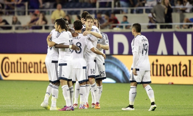 Vancouver Whitecaps players celebrate after win at Orlando City (Photo: Kim Klement-USA TODAY Sports)