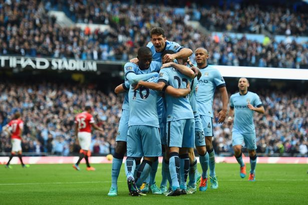 Manchester City celebrate against United earlier in the season (Photo: Getty Images, Shaun Botterill)