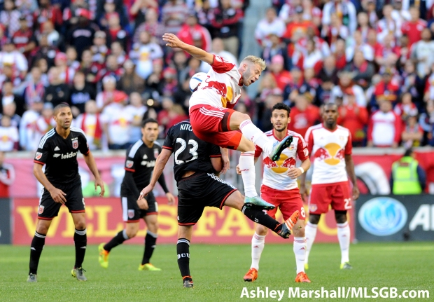 New York's Mike Gella jumps with Perry Kitchen during the MLS Eastern Conference Semifinal Second Leg: New York Red Bulls vs. DC United at Red Bull Arena in Harrison, New Jersey, USA, on Nov. 8, 2015. Photo: Ashley Marshall/MLSGB.com